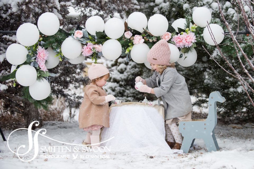 baby girl and big sister having a snowy tea party - boulder photographer