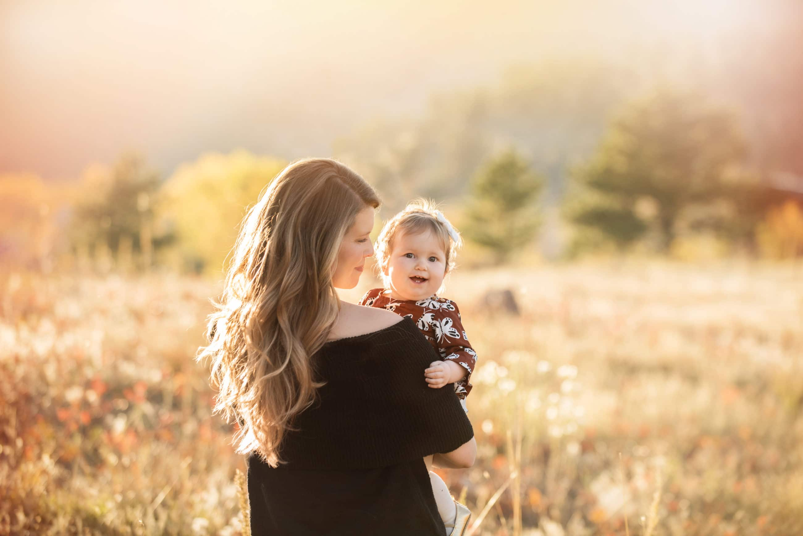 mother and little girl in a golden field at sunset with backlight - highlands ranch photographer