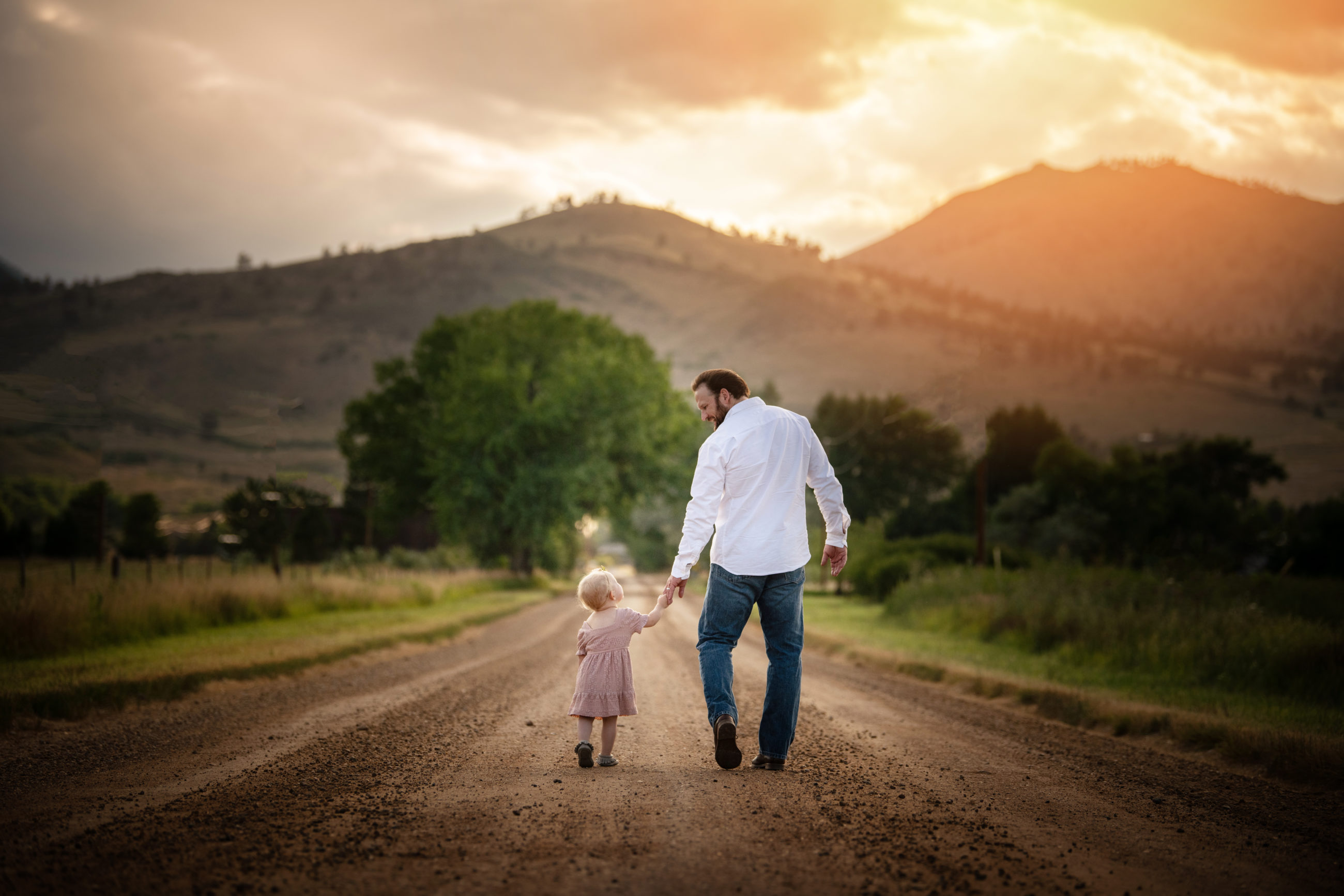 Mother daughter photo session | boulder family photographer baby girl walking down road with her dad at sunset